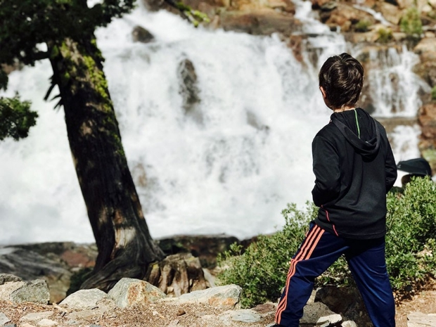 Boy in front of the falls