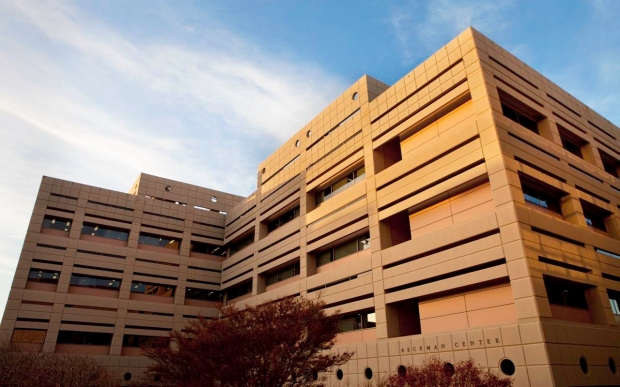 Image of Beckman Center building against clouds and sky