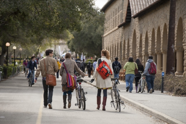 People walking bikes on Stanford main campus, courtesy of Linda A. Cicero/Stanford Medicine News