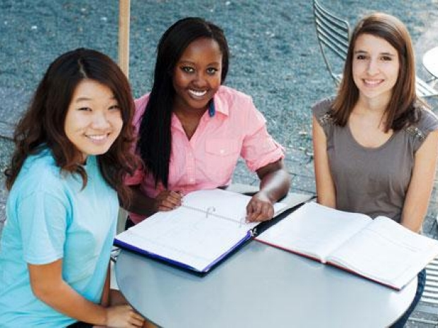 three girls studying
