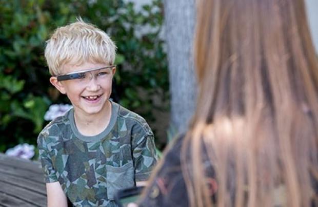 A boy wearing Google Glass