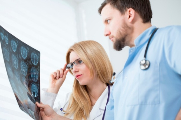 Doctor and student looking at xray