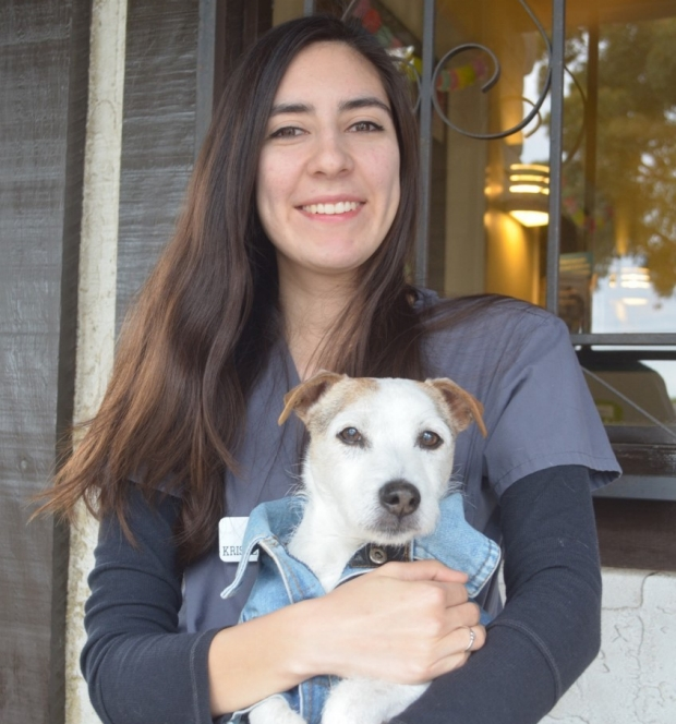 Portrait of Kristen Aceves with her dog Skip