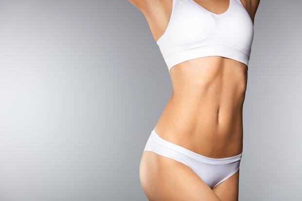 Closeup Beautiful Slim Woman Body In Perfect Shape In Bikini