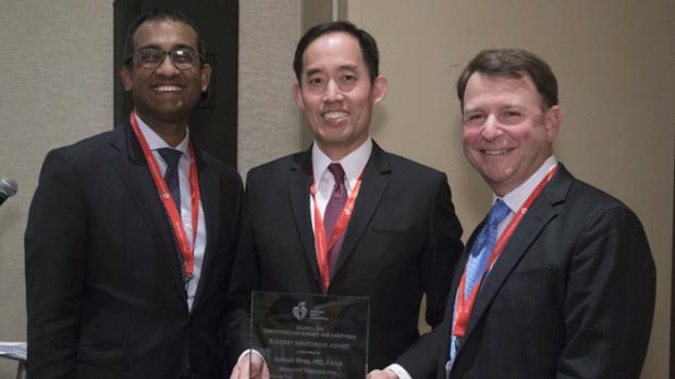 Joseph Woo winning an award at AHA conference