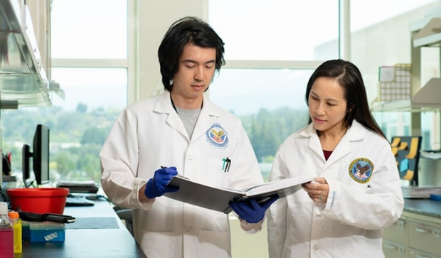 photo of Ngan Huang and Alex Chan looking at results in a lab