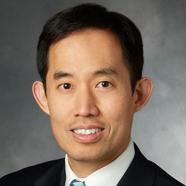 smiling headshot of Joseph Woo
