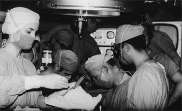 black and white photo of surgeons performing first heart transplant in the US
