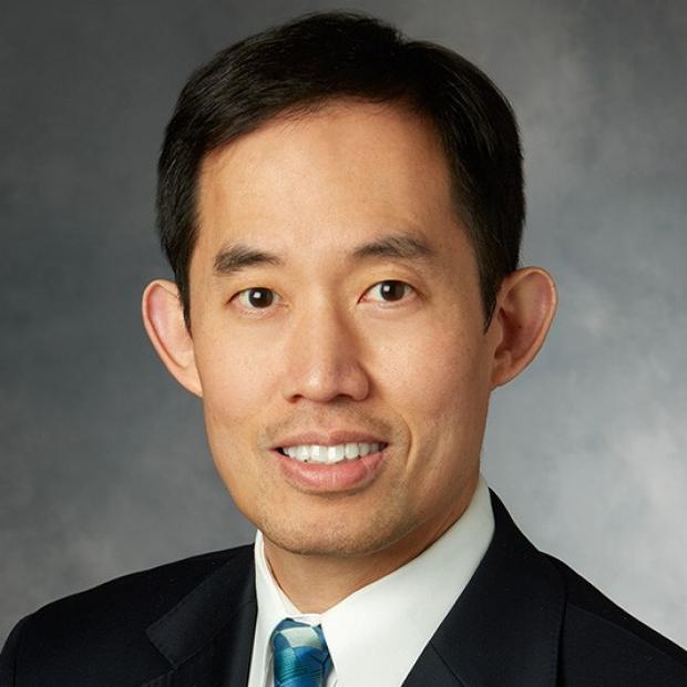 headshot of Joseph Woo