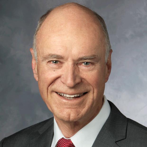 smiling headshot of Bruce Reitz