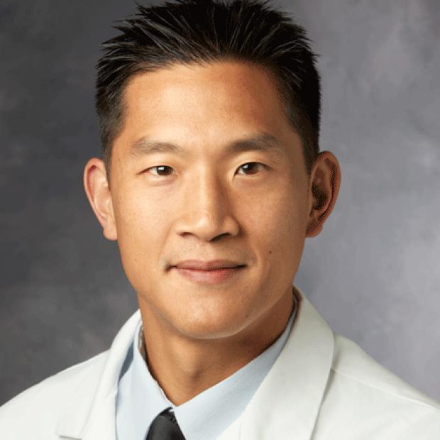 smiling headshot of Michael Ma