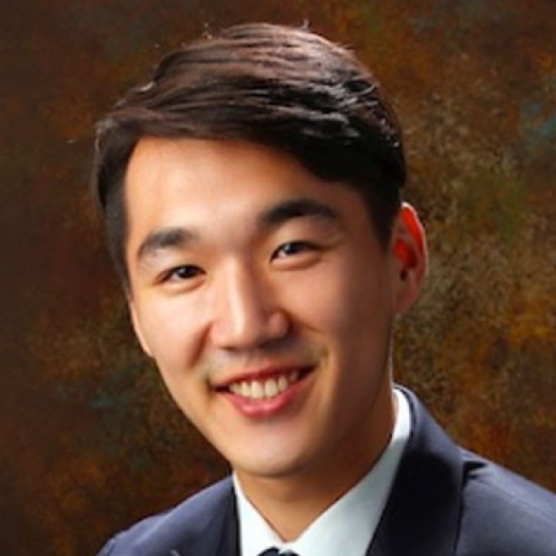 smiling headshot of Perry Choi