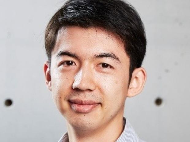 smiling headshot of Dr. Alex Chan