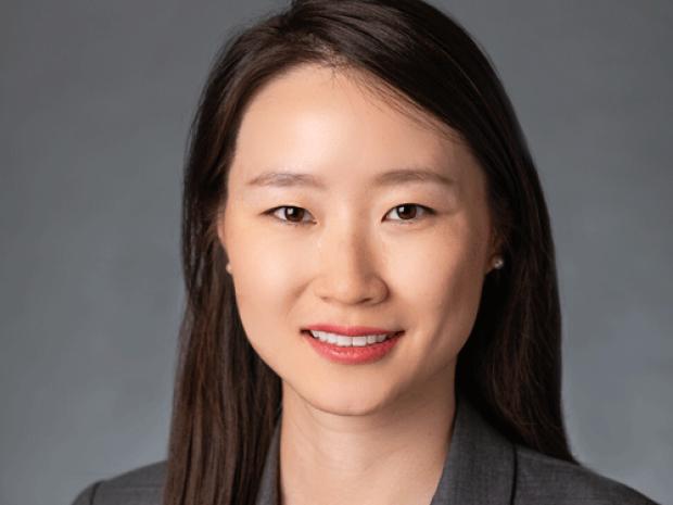 smiling headshot of Dr. Yuanjia Zhu