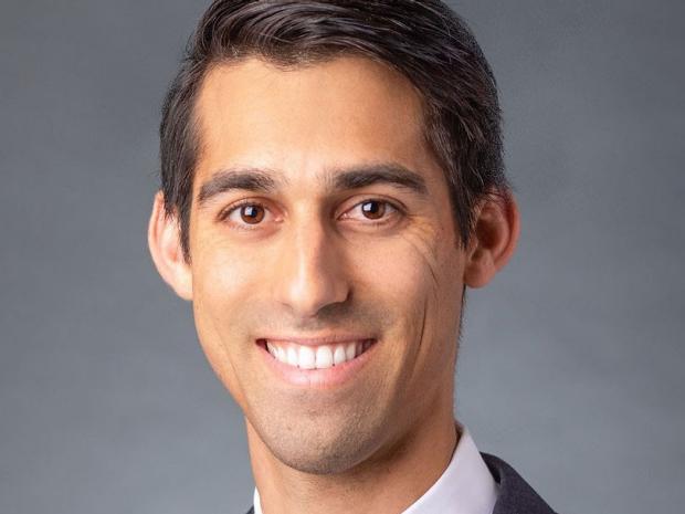 smiling headshot of Dr. Alex Dalal