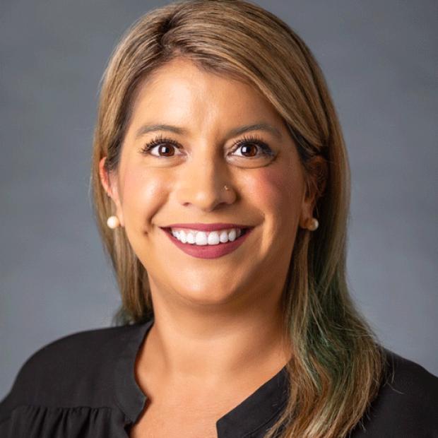 smiling headshot of Justine Santiago
