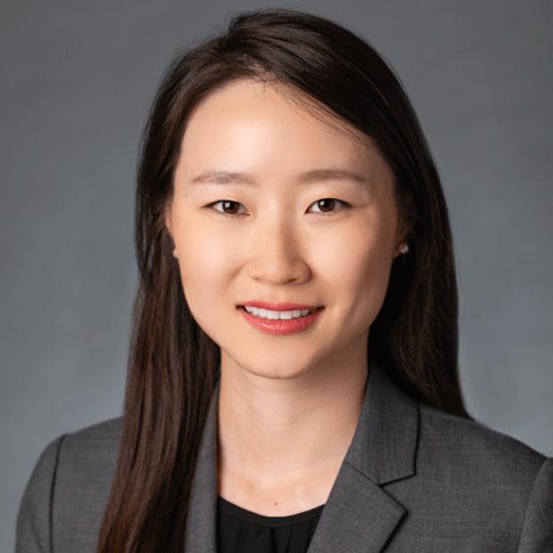 smiling headshot of Yuanjia Zhu