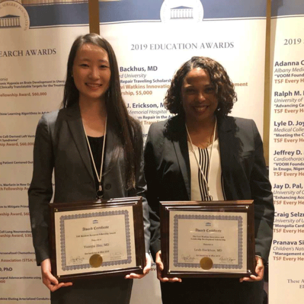 Yuanjia Zhu and Leah Backhus holding awards