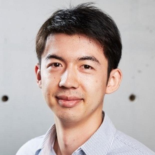 smiling headshot of Alex Chan