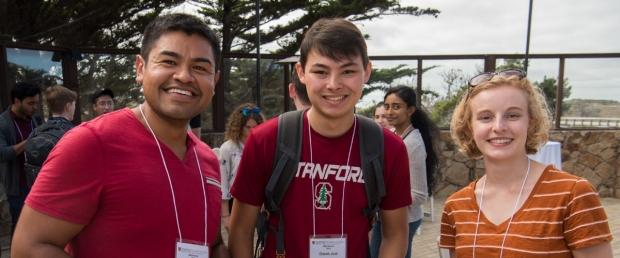 Three students smile at 2019 BMI Retreat, image courtesy of Steve Castillo Photography