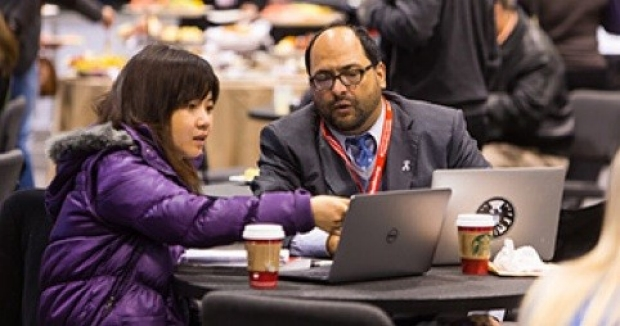 Ke Yuan, Postdoctoral Fellow and Dr. de Jesus Perez at the AHA Scientific Sessions 2014 in Chicago.