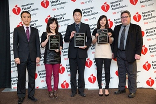 Ke Yuan, second from left, receives the 2014 AHA Cournand and Comroe Award. The top award for a yopung investigator offered by the AHA 3CPR Council for her work on pulmonary hypertension.