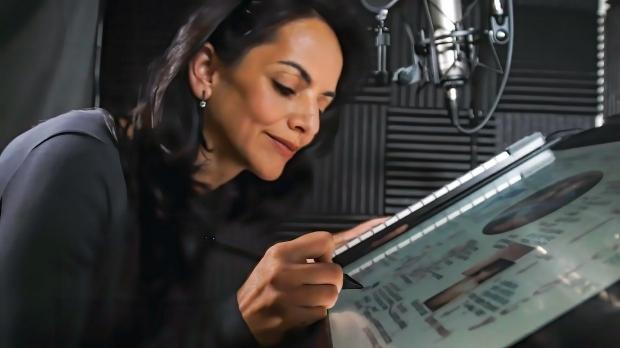 Dr. Maya Adam in a recording studio, illustrating on a tablet