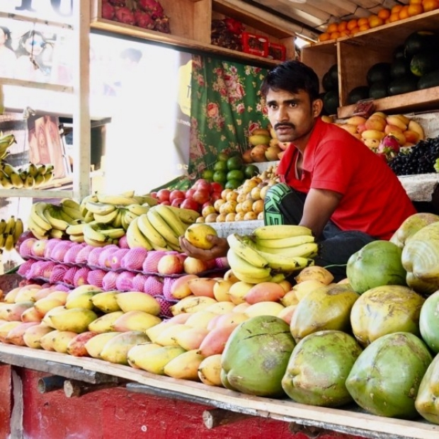 Image of man in fruit stand, courtesy of Melissa Viiron and Stanford School of Medicine