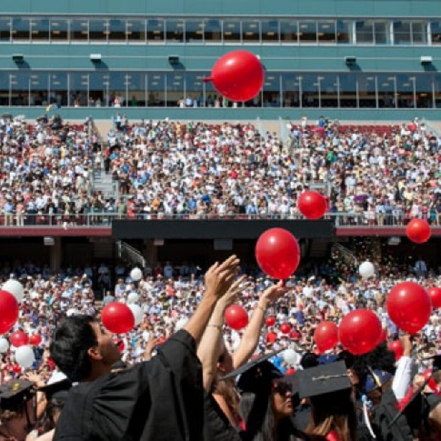 Graduation banner with red balloons floating into the sky