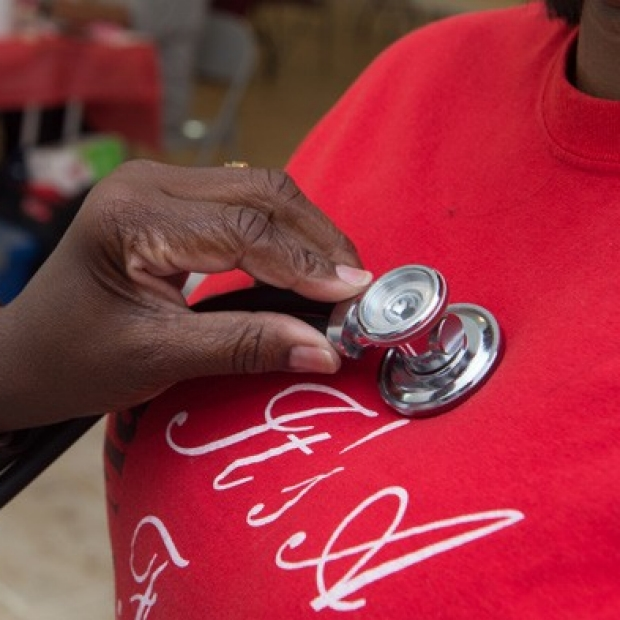 Mississippi CEC stethoscope image with woman in red shirt, courtesy of Jackson Health Study