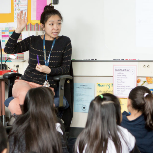 """Screenshot of image from Stanford News release. """"A teacher in the Graduate School of Education's Stanford Teacher Education Program teaching a class prior to the start of the COVID-19 pandemic."""" (Image credit: Joe Mazza Photography)"""