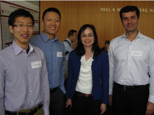 Group photo of Dr. Liao and colleagues in a conference