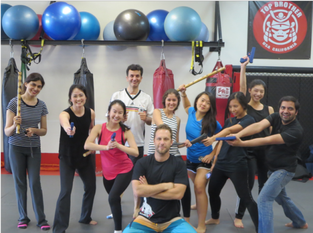 Photo of Dr. Liao and colleagues in a Krav class