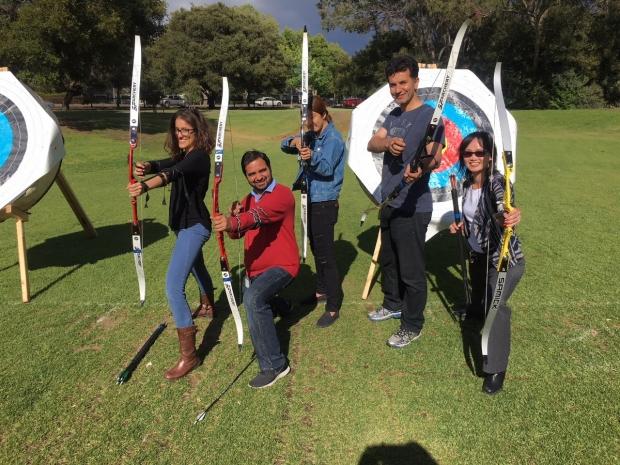 Lab members posing in an archery class