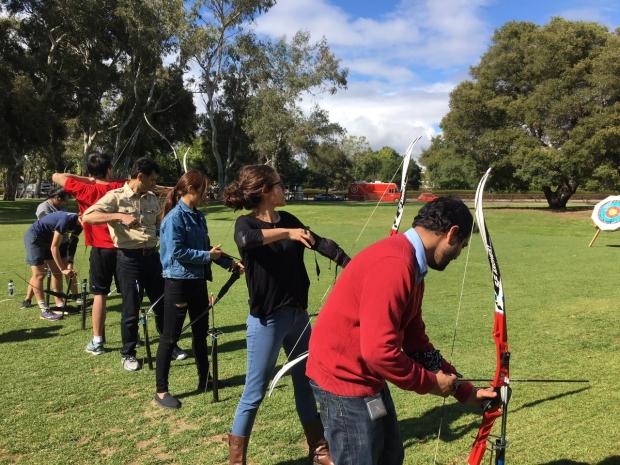 Lab members in an archery class