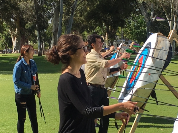 Lab members in an archery class moving arrows off targets