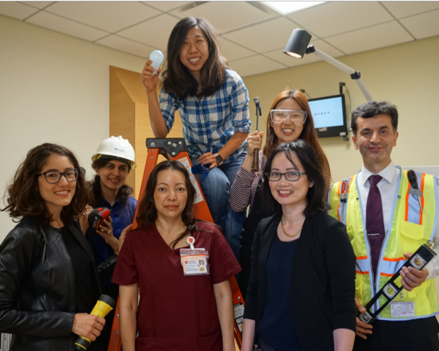 group photo of Dr. Liao and team working in offices