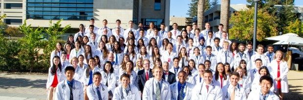 Group of people in white coats