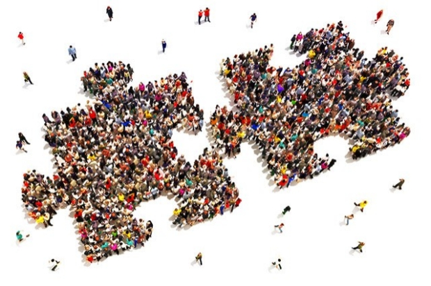 Overhead view of a crows of people shaped like puzzle pieces