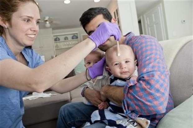 Doctor swabs twin babies bacteria to help create own microbiome
