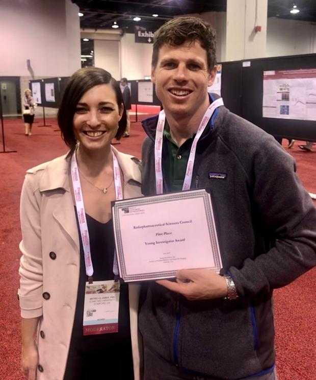 Marc Stevens holding award and Michelle James