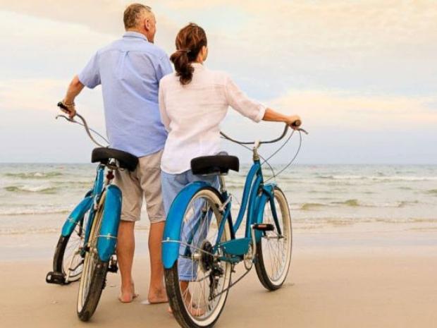 Photo: couple biking
