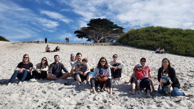 Group of people sitting on a beach