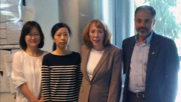 Photo of Yan He, Sheen-Woo Lee, Katherine Ferrara, and Sanjiv Sam Gambhir
