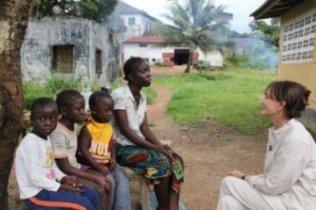 Photo of Nancy Snyderman with childran and a young woman in Liberia
