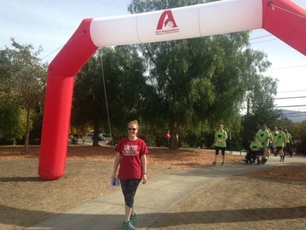 Jennifer Fisher crossing the finish line at the ALS Walk