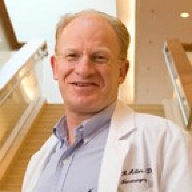 Dr. John Adler