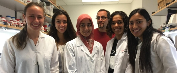 Palmer Lab Research Group in white lab coats