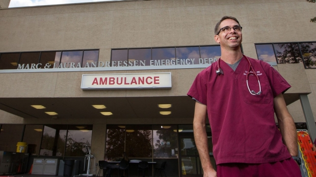 Physician who treated Ebola patients emerges from quarantine to hero's welcome