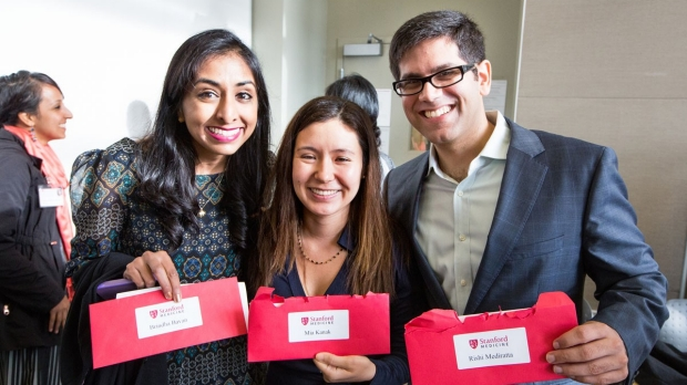 Medical students open envelopes and glimpse their futures